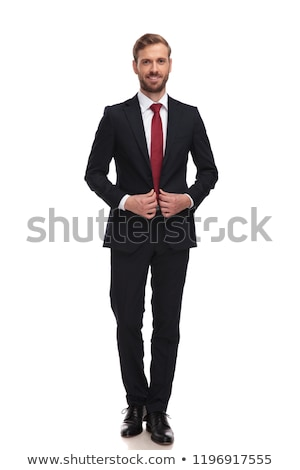 man in suit and tie unbuttoning his coat  Stock photo © feedough