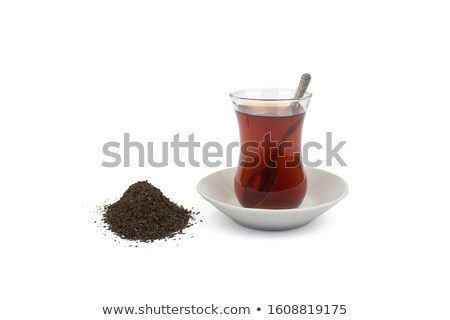 Closeup shot of teapot and glass on white background Stock photo © Nobilior