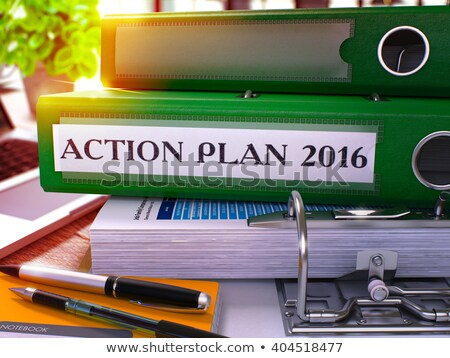 green ring binder with inscription action plan 2016 stock photo © tashatuvango