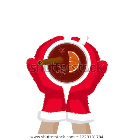 Stock photo: hands in gloves holding mulled wine
