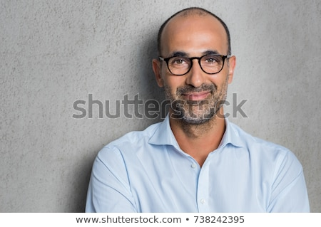 close up portrait of a young bearded man stock photo © deandrobot