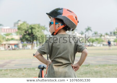 Boy with basket looking back Stock photo © IS2