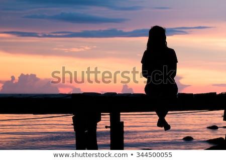 Silhueta triste casal sessão de volta nublado Foto stock © AndreyPopov
