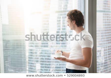 Düşünme yakışıklı adam pencere adam portre genç Stok fotoğraf © artfotodima