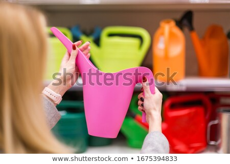 little girl with a garden watering can Stock photo © studiostoks