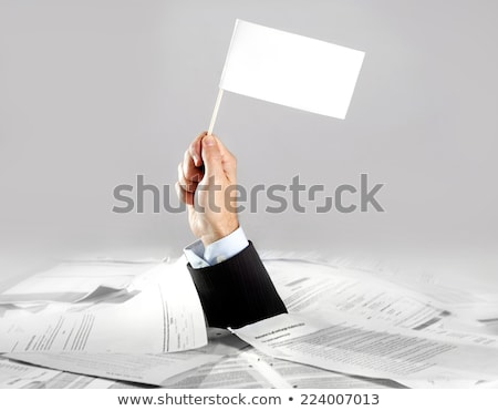 Businessman Holding White Help Flag In Office Stock photo © AndreyPopov