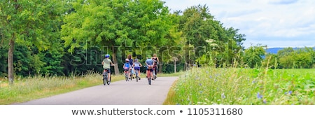 happy family riding bicycles in summer park Stock photo © dolgachov