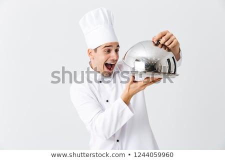 Vrolijk chef kok uniform tonen Stockfoto © deandrobot