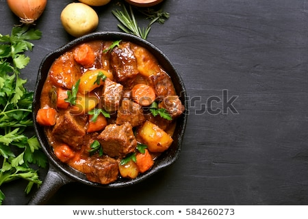 Roasted or stewed beef meat with tomato Stock photo © furmanphoto