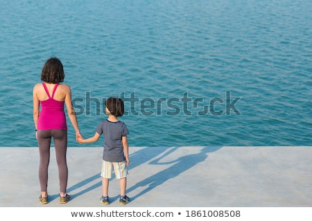 Mother with her son outside in an urban street Stock photo © Lopolo