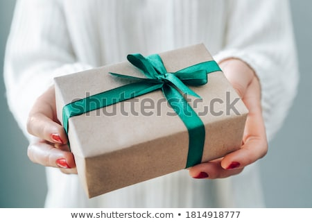 Stock photo: close up of woman in red sweater holding gift box