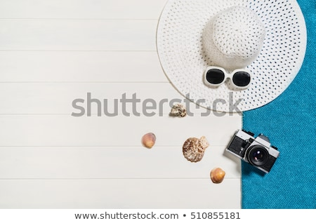 Flat lay, top view. Beauty and fashion concept. Beautiful female hands with red manicure. Minimal st Stock photo © serdechny