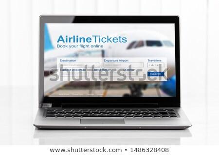 Laptop mutat online levegő jegy előre bejelentkezés Stock fotó © AndreyPopov