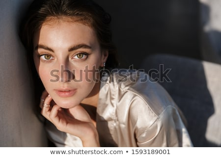 Woman indoors posing at home in silk robe Stock photo © deandrobot