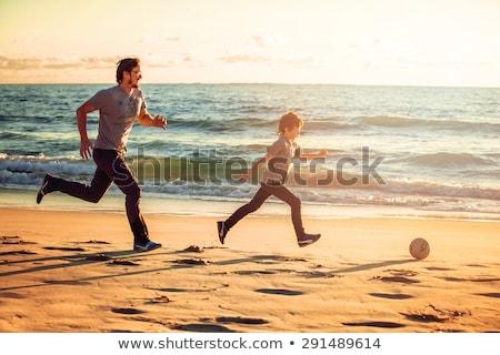父から息子 · 演奏 · ビーチ · 日没 · 時間 · 日 - ストックフォト © dotshock