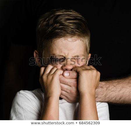 Felnőtt kéz erőszak fiú ijedt fiatal srác Stock fotó © Kakigori