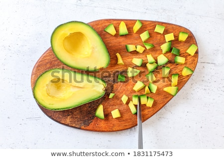 Stock photo: Avocados on a cutting board