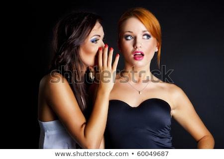 Secrets deux jeunes femmes Photo stock © yurok