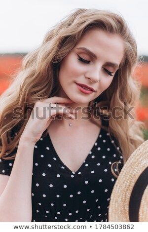 Portrait of a cute blondie stock photo © konradbak