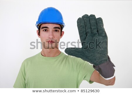 Young tradesman wearing an oversized glove Stock photo © photography33
