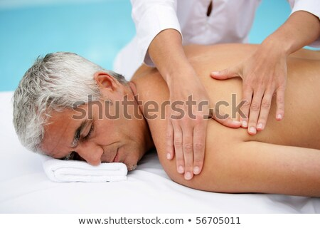 Laid man being massaged Stock photo © photography33