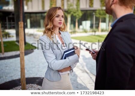 Femme d'affaires parler cellule regarder l'ordre du jour affaires Photo stock © photography33