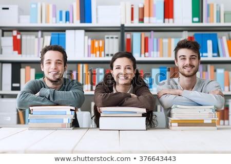 Három diákok könyvtár könyv internet dolgozik Stock fotó © photography33