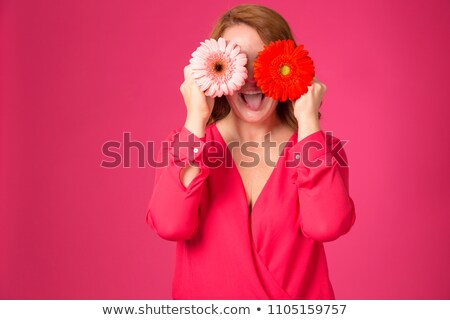 woman with red gerbera flowers in hair stock photo © feedough