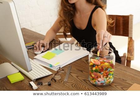 Businesswoman eating a hamburger Stock photo © photography33