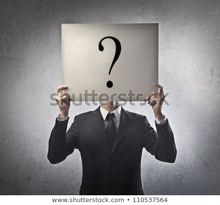 businessman holding a white paper with a question mark stock photo © ozaiachin