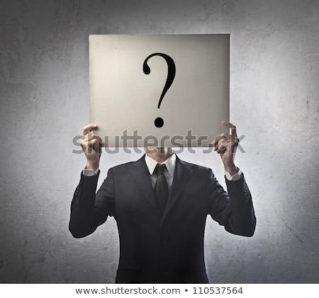 empresário · em · pé · ponto · de · interrogação · pontos · de · interrogação · ponto · pensando - foto stock © ozaiachin
