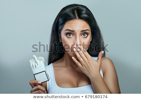 beautiful woman with a cigarette stock photo © acidgrey