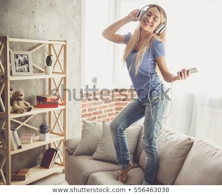 Retrato mulher dança ouvir música branco Foto stock © wavebreak_media