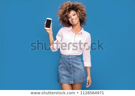Mulher jovem célula camisas mulher mão Foto stock © Andersonrise