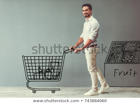 Man looking at pictures stored in camera Stock photo © stockyimages