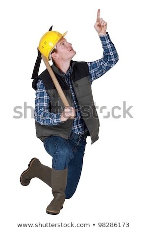 craftsman holding a pick and pointing up Stock photo © photography33