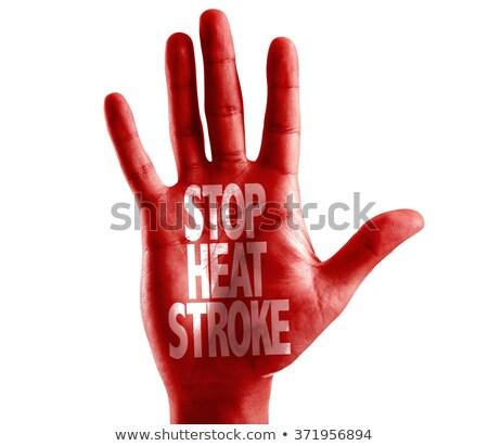 Stop calore open mano segno verniciato Foto d'archivio © tashatuvango