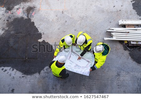 Onherkenbaar werknemers bouwplaats wazig taken Stockfoto © stevanovicigor