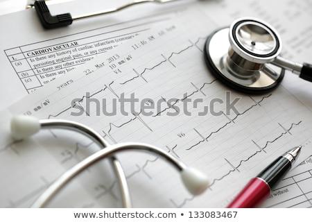 Tıbbi grafik stetoskop kırmızı yalıtılmış beyaz Stok fotoğraf © Klinker