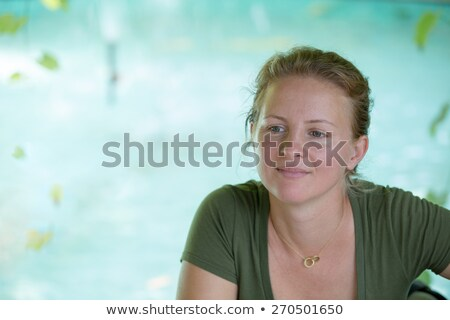 tranquil moments with a pretty woman at a pond stock photo © ozgur