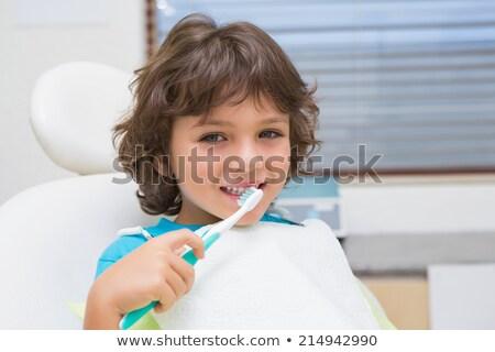 Pequeño nino dentistas silla dentales Foto stock © wavebreak_media