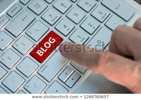 Blog - Clicking Yellow Keyboard Button. Stock photo © tashatuvango