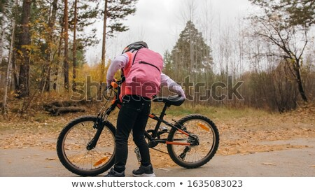 red and black mountain bicycle standing in park stock photo © ziprashantzi