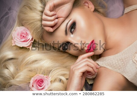 Beautiful romantic woman with long blond hair in a wreath of lil Stock photo © dashapetrenko