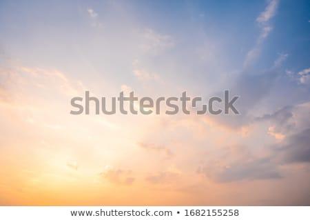 nap · mögött · citromsárga · felhők · ragyogó · sötét - stock fotó © oakozhan