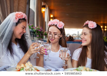 Group happines women with champagne at hen party Stock photo © Yatsenko