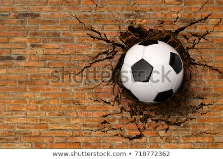 football hitting the wall with cracks background Stock photo © SArts