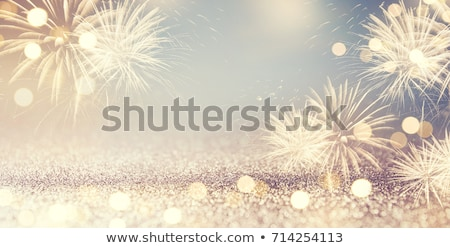 sparkling golden green fireworks stock photo © tasipas