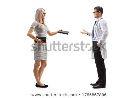 Full-length shot of young woman in library Stock photo © deandrobot