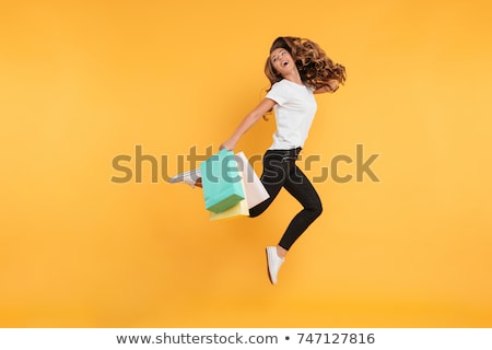 Cheerful young brunette lady looking aside Stock photo © deandrobot